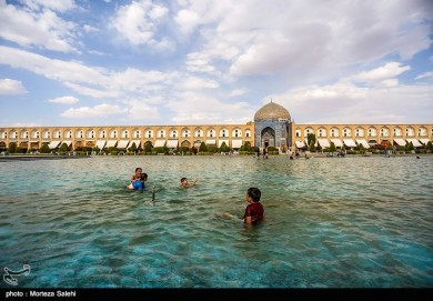 Children Playing with Water in Isfahan