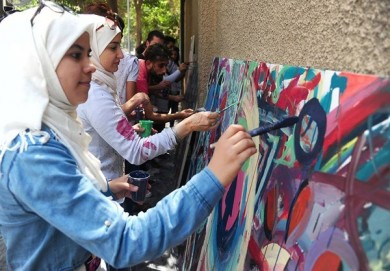 Draw Paintings on Sidewalk in Damascus, Syria
